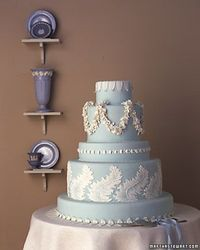 Wedgwood Wedding Cake The icinglike trim on jasperware, developed in England in 1775, translates well to a wedding cake -- piped here in royal icing. This cake and base were covered with fondant; gum-paste leaves adorn the base and top.