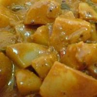 Delightful Indian Coconut Vegetarian Curry in the Slow Cooker It's extremely easy to prepare in the crock pot. Deliciously creamy, it can be served by itself, with rice, or with steamed soft tortillas. Also makes a good samosa filling. It has a nice t...