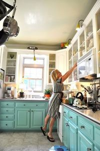 Cute kitchen, the owner repainted the original wood cabinets and it made a ton of difference!