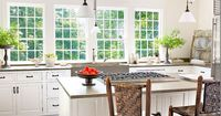 Rustic beams. Whitewashed walls. Bank of windows. Great plate rack. Kitchen by Nancy Fishelson.