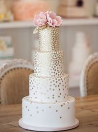 We love how the gold dotting falls down this wedding cake, giving it a modern, but still elegant twist.