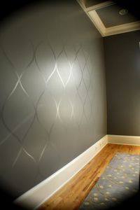 Use a high gloss paint over top of a flat paint to create a subtle design. This would be great for an accent wall.