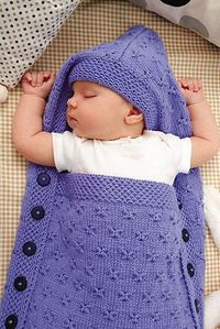 Knitted but can be easily crocheted. Ravelry: #28 Hooded Sleep Sack pattern by Jeannie Chin