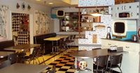 50's Prime Time Cafe at Disney's Hollywood Studios WDW - The decor really does transport you to a Leave It to Beaver-style kitchen table. The black and white TVs showing classic clips complete the atmosphere. And the servers making sure you keep y...