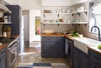 Love the Spanish tile backsplash in this kitchen! | Home Tour: Rustic California Bungalow | Decorating Files