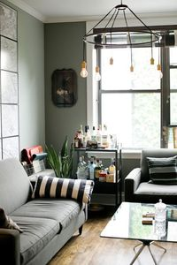 Get the Look : Halo Chandelier from Roost is open and industrial lighting for this loft living room.