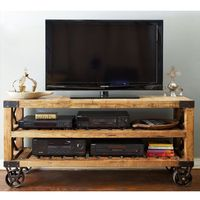 Recycled Pine Console -- Industrial chic is in, especially the period from about 1880 to 1920. This cart can be used in several ways, here in the family room as a TV stand, in the playroom in the next pic, or even in the kitchen for extra storage.