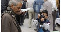 Qamar Hashim, an 8 year old in Iraq has recently been certified the youngest professional photojournalist in Iraq, an accolade he prints on his own business cards. Last year he won gold in a photography competition open to all ages. He is an official memb...