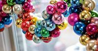 """Ornament Garland Ornament Garland �€"""" why didn't I think of that? String several cheap ornaments onto ribbon, and hang the swag on a mantel or doorway."""