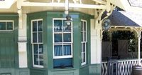 """New Orleans Square: The telegraph office attached to the New Orleans Square Railroad Station, replays a part of Walt Disney's Disneyland Opening Day Dedication in Morse code. """"TO ALL WHO COME TO DISNEYLAND, WELCOME. HERE AGE RELIVES FOND MEMORIE..."""