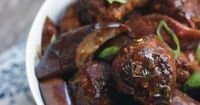 An Asian-inspired meatball recipe with stir-fried eggplant in a spicy, salty and sweet sauce that that is Keto, LCHF, Paleo and Atkins Diet friendly.