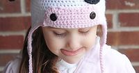 So cute from http://www.ravelry.com/patterns/library/moo-cow-earflap-hat