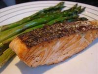 Broiled Salmon With Asparagus. Delicious seasoned and broiled salmon, together with stalks of asparagus.