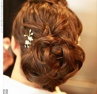The bride wore her hair pulled back in a messy bun to show off the back of her dress. She accented the look with sparkly hairpins her mother found from a designer in New Jersey.