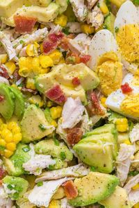 This Avocado Chicken Salad recipe is a keeper! Easy, excellent chicken salad with lemon dressing, plenty of avocado, irresistible bites of bacon and corn. No cooking required for this healthy Chicken Cucumber Avocado Salad.