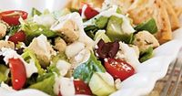 Checkout this filling Greek Chicken Salad Recipe at LaaLoosh.com! With just 4 Points + for a huge serving, this low calorie Greek Salad is sure to leave you fee