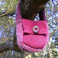 This easy Autumn Berry Bag is the perfect project for beginners who are ready to try knitting more than just scarves. Knit with straight knitting needles, this