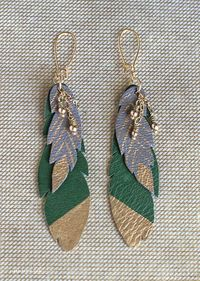 Make your own DIY leather feather earrings and necklace with this simple tutorial from Lia Griffith.