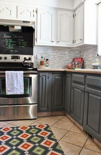 Grey and White Kitchen Makeover with Tile Backsplash and Chalkboard | House For Five featured on Remodelaholic.com #whitekitchen #diy #twotone