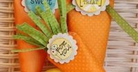 Easter Bunny Carrots {DIY Ideas} These cute paper carrots can be made any size and are a great party favor to send your Easter guests home with at the end of the day. You could even add the guest names and hang them off the seat backs with ribbon and they...