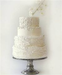 #White #wedding #cake with lots of #ruffles