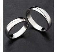 http://www.gullei.com/custom-engraved-sterling-silver-couples-wedding-rings-for-2.html