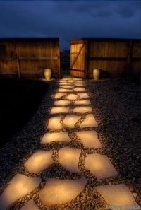 "Clever! Pathway of rocks painted with glow in the dark paint (Rust-Olem Glow in the Dark Brush-on Paint). During the day they ""charge"" in the sun and in the evening they reflect stored light! How cool!"
