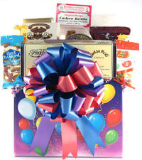 Balloons, celebrations and treats are what this basketis all about! Fine French truffles, chocolate fudge, chocolate chip cookies, a tin of mixed fruit drops, gourmetcoffee, 2 Toblerone chocolate bars, Blue Diamondalmonds, Jelly Belly jelly beans and even...