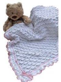 Fluffy Clouds Blanket Crochet Pattern Download from Anniescatalog.com -- The shell stitch design in this beautiful crocheted baby blanket pattern come together to create billows of heavenly softness reminiscent of a big puffy cloud.
