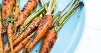 Our new charcoal grill has been the source of much inspiration this summer, from bean burgers to Spanish fare to salad greens. So when the carrots from our