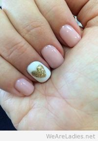 Pink daisy gel nail polish with gold glittered heart decorated nail