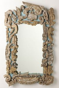 pretty clever using all broken pieces of decorative molded or carved wood fashioned into a design-type frame
