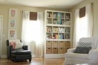 They are three Expedit (ikea) bookshelves stacked on top of each other. The bookshelves are sitting on a base basically built a box for the bookshelves to sit on and trimmed it out with the same quarter round that goes around our baseboard. I love...