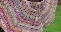 Eva's shawl: can be made any size; 2 skeins (590 yds) used here; hook size depends on yarn. Worked in CH, SC, & DC. Skill level: beginner. Gorgeous colors used on this one - Noro Silk Garden Sock, colorway 279. *Free* pattern here http://m...