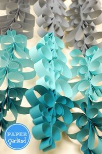 TUTORIAL: Anthropologie Inspired Paper Scroll Garland - Perfect for Hanukkah Parties, or used as backdrop for any dessert or buffet table!