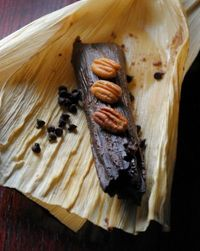 Chocolate Tamales ~ A chocolate based masa with a hint of chile and lightly sweetened with piloncillo. Filled with pecans and chocolate chips
