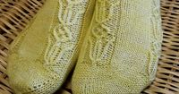 Ravelry: Pushing Up Tulips Socks pattern by Kelli Slack