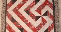 red-black swirl quilt 006: clever design, it starts with the pinwheel