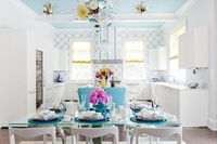 blue ceilings, white kitchens and contemporary dining rooms.