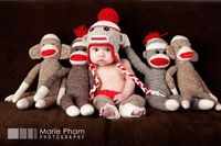 I had topostit even though not for Olivia. If I had a boy this would have made me want to make sock monkeys his first birthday theme just so I could do this picture. So cute!