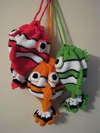 Ravelry: Appliejuice's Something's Fishy purses. Absolutely adorable! .. #crochet inspiration