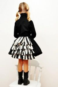 I love bustled dresses. Not only is this a fabulous tutorial for a great skirt, but she completes the ensemble with a faux fur cape to boot! Her daughter's one