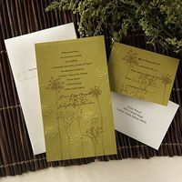 Embossed wildflowers are accompanied by silhouettes that reach up toward your wording on this citrus, non-folding invitation.