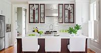 Two-tone cabinets turn the back wall of this open kitchen into a focal point.