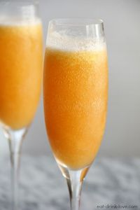 Peach Bellinis - an easy frozen peach bellini made with peaches and champagne! Perfect for New Year's Eve!