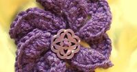 Plum Blossom crochet flower brooch. $14.00, via Etsy.