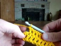 In this tutorial, we learn how to make a standard blanket from crocheting. First, you will start your crochet by positioning the material into your hand. Then,