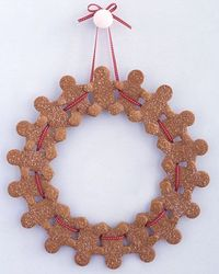 DIY. Cute Gift: Who wouldn't adore this Gingerbread Man Wreath as a holiday gift! How sweet it would look hanging in the kitchen!