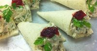 Tea Party Sandwiches - No recipe, looks like chicken salad in a rolled piece of bread, with a dab of cranberry sauce and a parsley leaf...