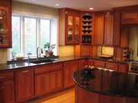 Color of cherry cabinets and dark countertop